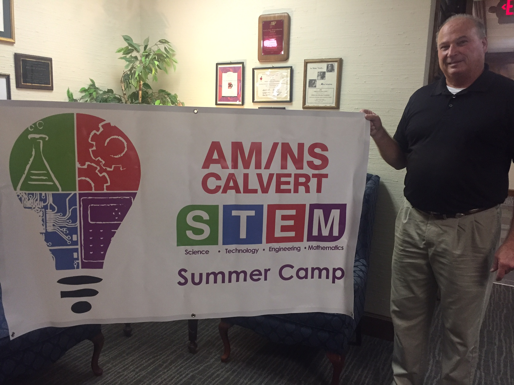 AM/NS camp banner